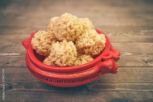Valokuvatapetti Indian Traditional Snacks Puffed Rice Balls