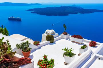Santorini island, Greece: Landmark detail of a terrace decorated with flowers over the caldera Caldera
