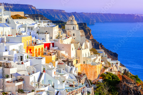 Foto op Plexiglas Purper Fira, Santorini island, Greece: Traditional and famous white houses over the Caldera, Aegean sea.