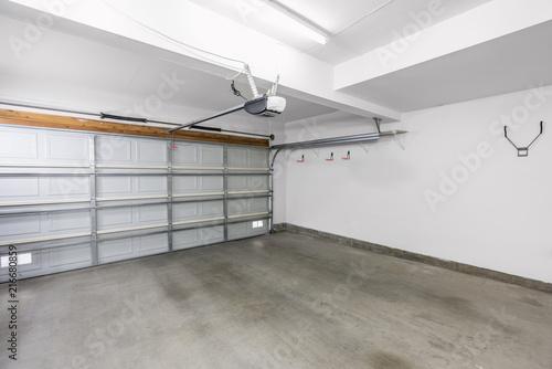 Fotografie, Obraz Empty residential garage in modern suburban home.