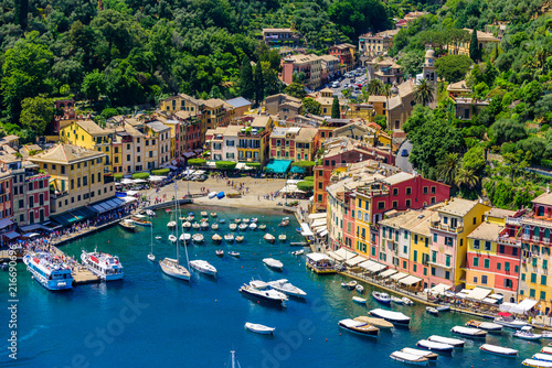 Obraz na plátně Portofino, Italy - colorful houses and yacht in little bay harbor
