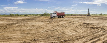 Trucks And Heavy Machinery Clearing The Land For The Construction Of A Solar Energy PV Plant At Choluteca, Honduras