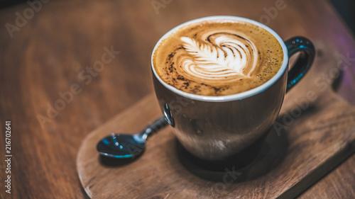 Fotografie, Obraz  Hot Latte Cup On Wooden Saucer