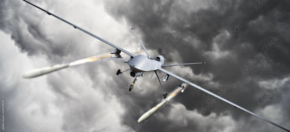 Fototapeta Drone strike .Front view of an unmanned aerial vehicle (UAV) military drone firing missile rockets at a target . 3d rendering
