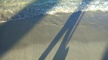 Walking Shadow Near The Beach