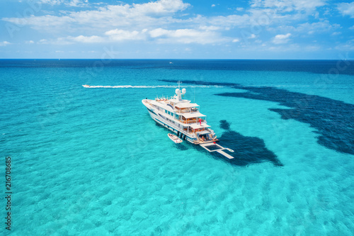 Fotografía Yacht on the azure seashore in balearic islands