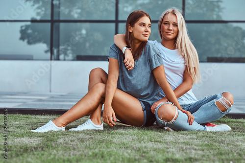 Two smiling girls cuddling ...