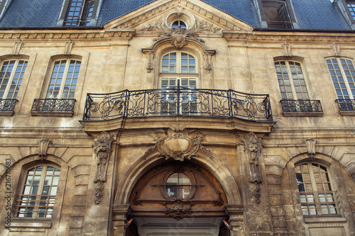 View of a traditional, historical building in Paris showing Parisian / French architectural style. It is a sunny day in spring. 3rd arrondissement