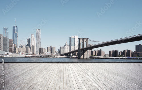Canvas Prints Brooklyn Bridge empty street with modern city new york as background