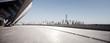 Leinwandbild Motiv empty street with modern city new york as background