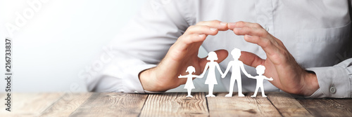 Fotografie, Obraz  Protecting Hands Over Paper Family / Family Protection And Care Concept