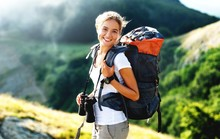 Woman With Backpack Trekking T...