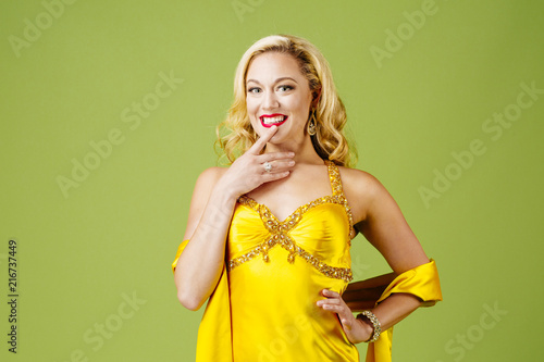 Photo  Yes, I definitely want it, portrait of an elegantly dressed blonde woman in yell
