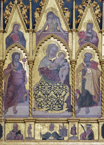 BOLOGNA, ITALY - APRIL 18, 2018: The detail of polyptych with the Madonna, St. Peter and John the Baptist on the side altar of St. Brigid in Basilica di San Petroniois by Tommaso Garelli (1477).