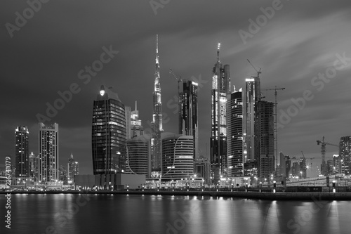 Foto op Aluminium Stad gebouw DUBAI, UAE - MARCH 24, 2017: The evening skyline over the Canal and Downtown.