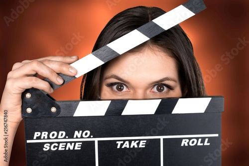 Photo  Young woman with movie clapper