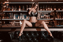 Dance In A Bar Concept. Pole Dance Concept. Girl With A Beautiful Figure And Long Legs Dancing On The Bar. Ideal Figure. Creative Magenta Toning
