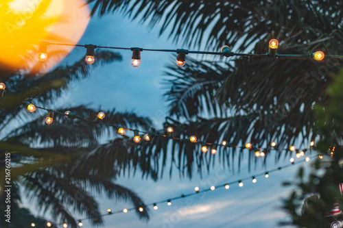In de dag Palm boom blurred light bokeh with coconut palm tree background on sunset