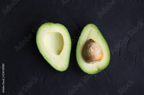 Avocado fruit on a black background