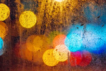 Dirty Glass Close Up On The Background Of Colorful Night Bokeh
