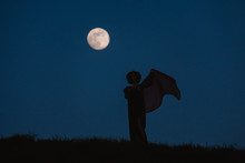 Beautiful Silhouette Of A Young Woman Against A Background Of The Night Sky