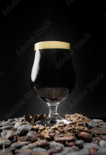 Dark Black Stout Beer Pint Over a Pile of Cocoa Nibs and Beans Wallpaper Mural