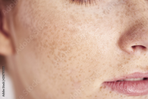 Fényképezés  Close up of woman's face with freckles