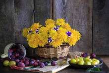 Yellow And Blue Plums With Flowers