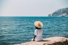Black Woman With Straw Hat Enjoying The Views