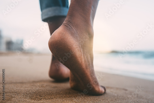 woman walking on the beach barefoot
