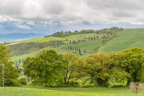 Foto op Canvas Pistache Tuscan rural landscape view with rain clouds over the valley