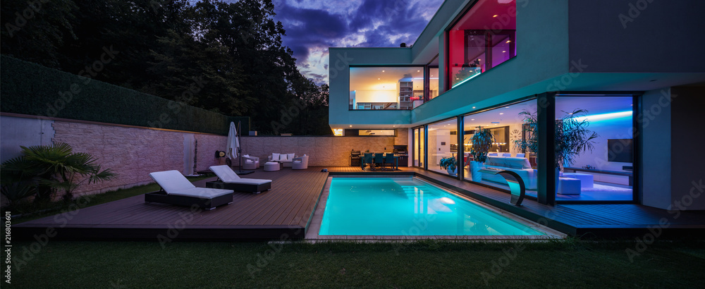 Fototapeta Modern villa with colored led lights at night