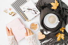 Workspace With Notebook With Empty Card, Coffee Cup Wrapped In Scarf,  Glasses. Stylish Office Desk. Autumn Or Winter Concept.  Flat Lay, Top View