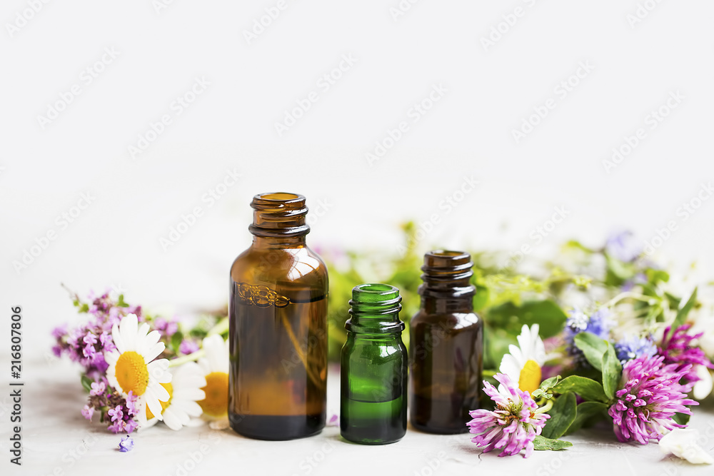 Fototapety, obrazy: Flowers and herbs essential oil bottles, natural aromatherapy with oils and essences