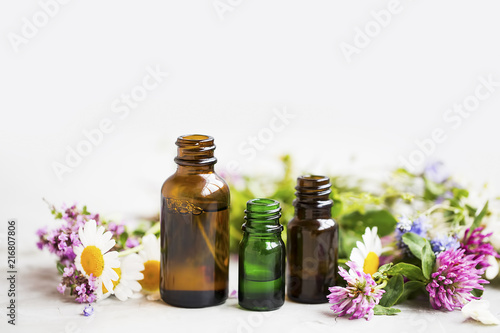 Vászonkép  Flowers and herbs essential oil bottles, natural aromatherapy with oils and esse