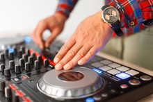 Man DJ Plays On The Mixing Console Close-up