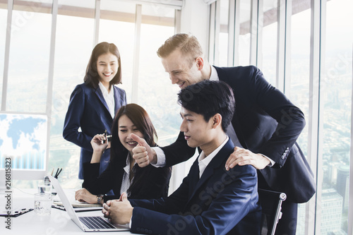 Fotomural Manager or boss looking at work and admire by showing thumb for good job and successful working in meeting room