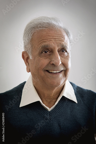 Older happy man looking away