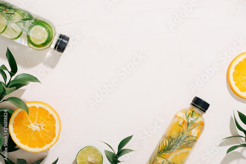 Fotografia, Obraz  Leaves and bottle tropical water on white background