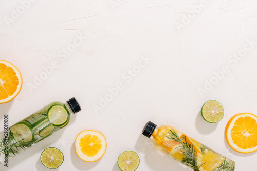 Fotografia, Obraz  Fresh summer lemonade with citrus, orange and mint on yellow background