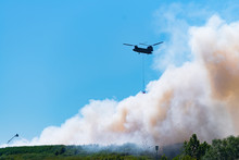 Chinook Helicopter Extinguishes A Large Fire