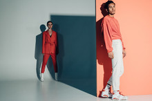 Casual Couple In Red Leaning A...