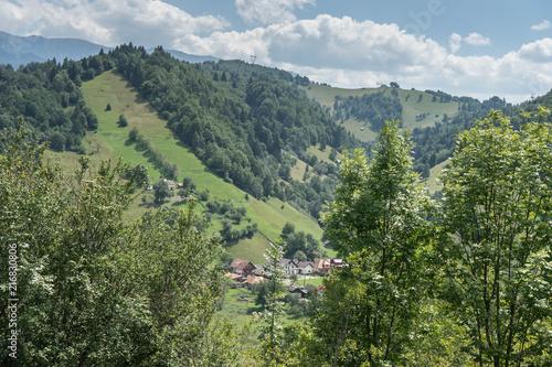 In de dag Olijf Mountain landscape and villages on the Rucar Bran corridor, in Transylvania, Romania