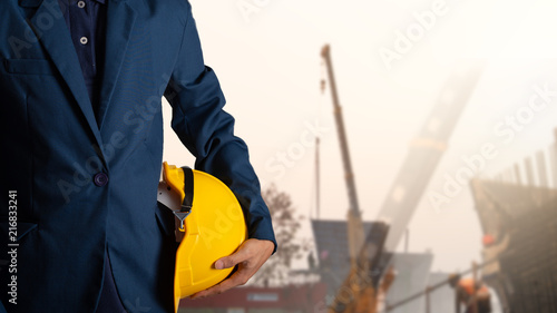 Fototapety, obrazy: Engineer or worker hold yellow helmet for workers security