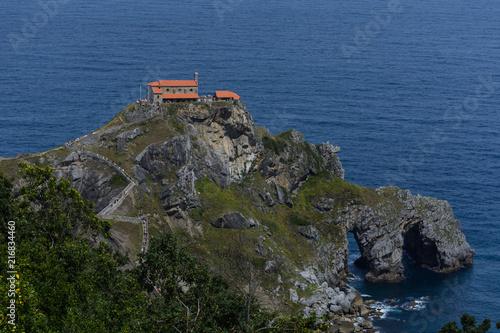 Photo  Close up to the San juan de Gaztelugatxe's chapel above some rocks at the Basque