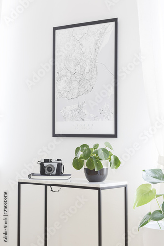 Poster Hoogte schaal A city map poster on a white wall, plant and camera on a box frame, marble top table in a stylish living room interior for a traveler