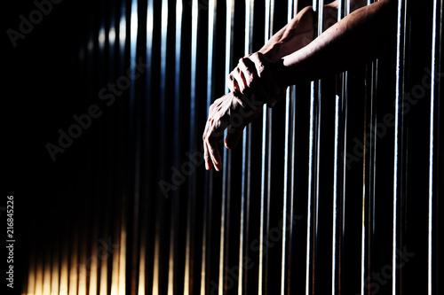 Billede på lærred close up of prisoner hands in jail.