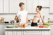 young couple looking at each other in kitchen