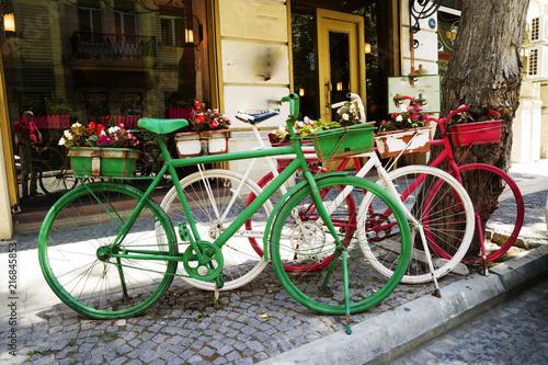 Türaufkleber Fahrrad Parking for three rental bicycles at street