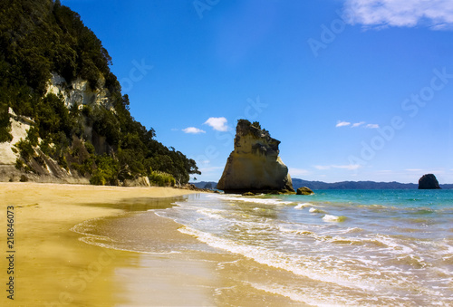 Cathedral cove rock on the perfect picturesque beach of the Coromandel peninsula